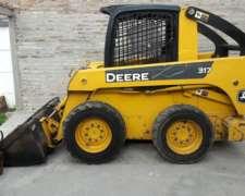 Minicargadora John Deere 317