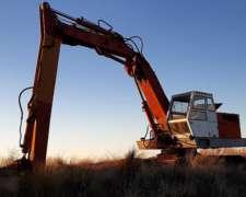 Retroexcavadora Poclain Lc80. con Oruga y Brazo Largo