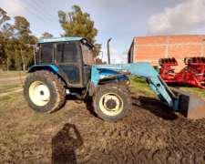 New Holland TL 75 con Pala Frontal
