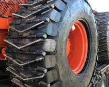 Cadenas, Cubre-ruedas, Rolos Trituradores y Topadoras