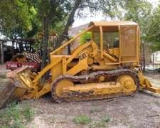 Traxcavator Caterpillar 933 con Pala