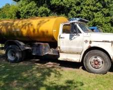 Camiones Chevrolet con Caja Volcadora y Tanque de Agua