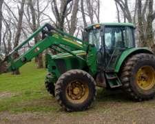 Tractor John Deere 6415 DT año 2010 con Pala JD 673