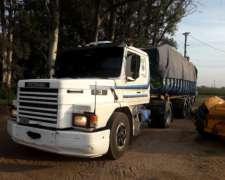 A Scania 113 con Batea