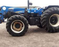 New Holland 7630 con Pala