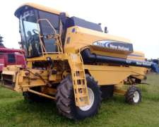 Cosechadora New Holland TC 57, con 23 Pies - año 2006